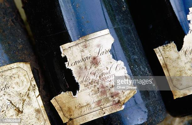 Detail of weathered labels on bottles of Domaine Laroche.