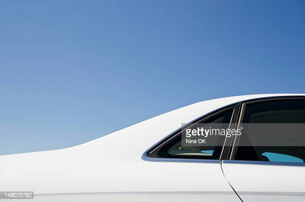 Detail of white car and blue sky