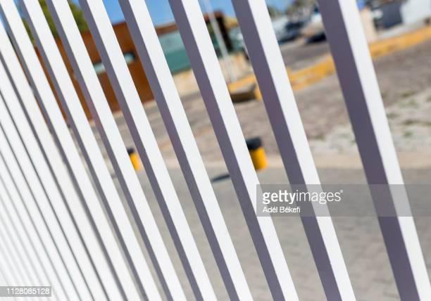 detail of white fence - build grill stock photos and pictures