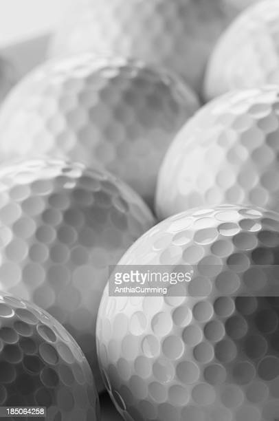 Detail of white golf balls close up and cropped