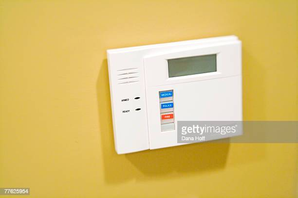detail of white security system panel on yellow wall - dana white stock pictures, royalty-free photos & images