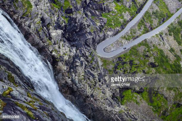 Detail of winding road next to waterfall, Trollstigen, Norway