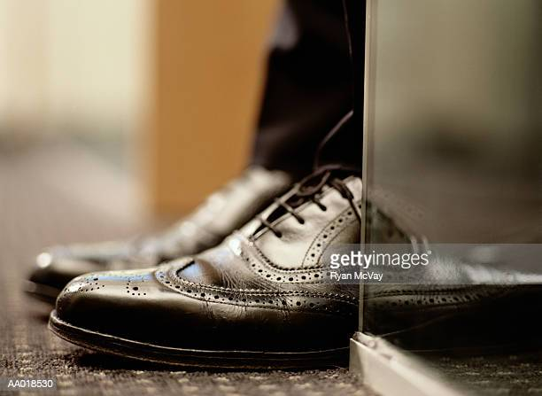 detail of wingtip shoes - dress shoe stock pictures, royalty-free photos & images