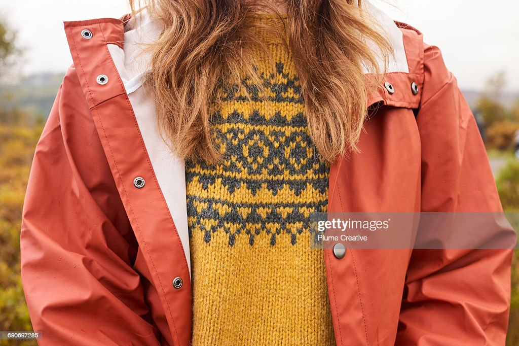 Detail of woman's jumper and waterproof jacket : Stock Photo