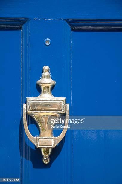 Detail of wooden blue door in Portobello Road, London (United Kingdom)