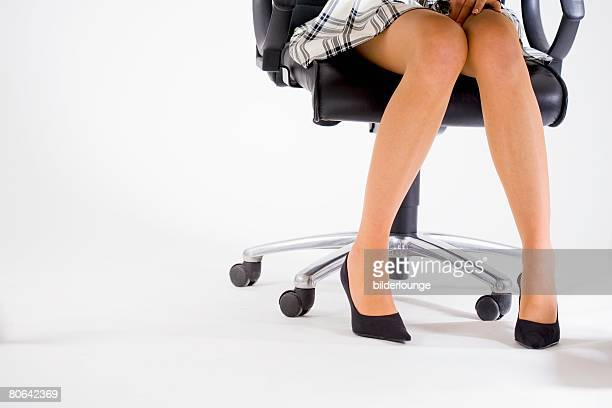 detail of young office worker's legs