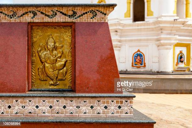 detail on wall of the shri mahalsa temple - panjim stock photos and pictures