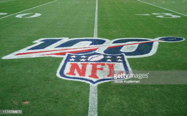 Detail photo of an NFL 100 logo on the field before the game between the Carolina Panthers and the Tampa Bay Buccaneers at Bank of America Stadium on...