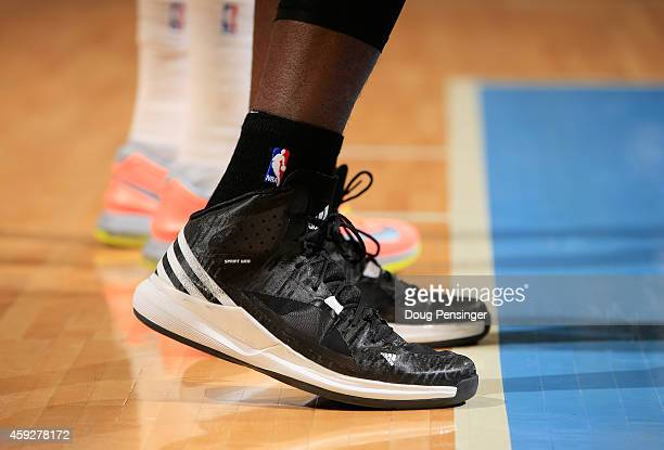 A detail photo of the court shoes of Serge Ibaka of the Oklahoma City Thunder as he faces the Denver Nuggets at Pepsi Center on November 19 2014 in...