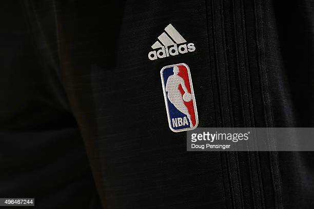 A detail photo of the NBA logo on the Adidas warm up if the Portland Trail Blazers as the prepare to face the Denver Nuggets at Pepsi Center on...