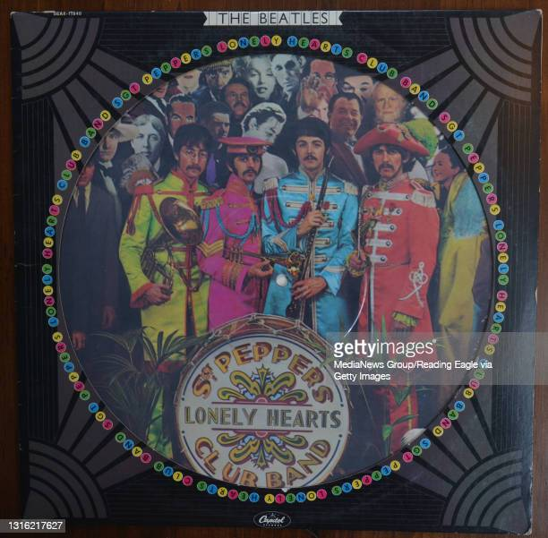 Detail photo of the Sgt. Peppers Lonely Hearts Club Band vinyl LP record. This is a picture disc album with the photo printed on the record. It is...