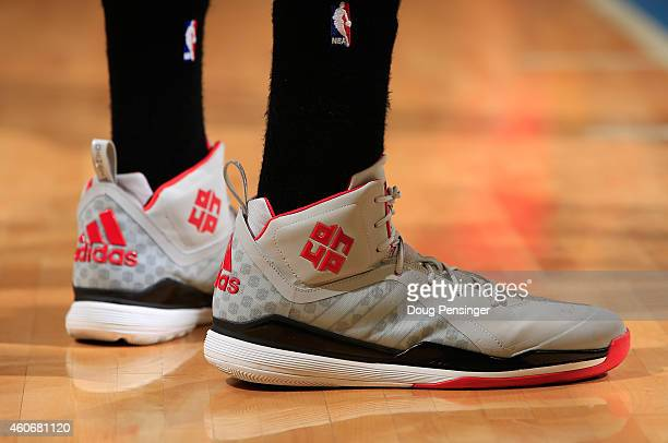 A detail photo of the shoes of Dwight Howard of the Houston Rockets as he faces the Denver Nuggets at Pepsi Center on December 17 2014 in Denver...
