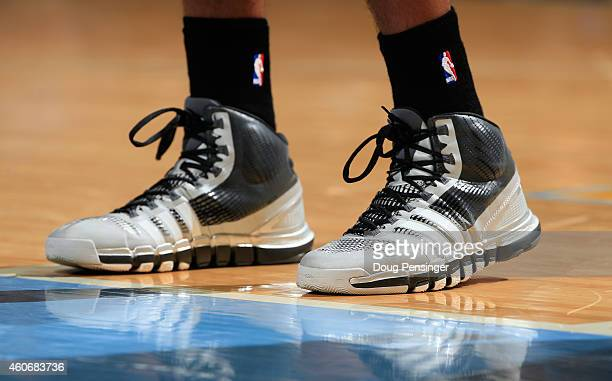 A detail photo of the shoes of Tim Duncan of the San Antonio Spurs as he faces the Denver Nuggets at Pepsi Center on December 14 2014 in Denver...