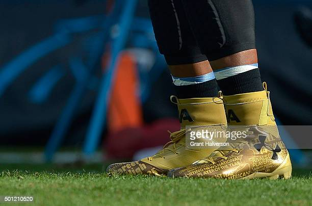 Detail photo of Under Armour cleats worn by Cam Newton of the Carolina Panthers as he warms up before their game against the Atlanta Falcons at Bank...