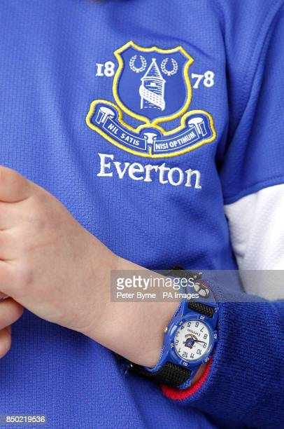 Detail picture of an Everton watch and shirt crest worn by a young fan on the Everton Roadshow stage