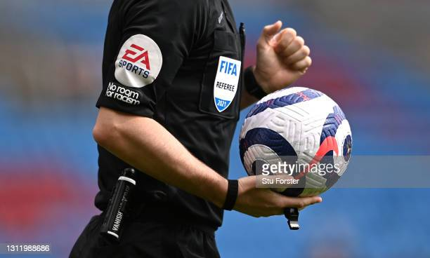 Detail picture of the Nike matchball and EA Sports and No Room For Racism logo's on the shirt of referee Anthony Taylor during the Premier League...