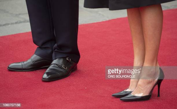 Detail picture showing the shoes of King Felipe VI of Spain and Queen Letizia while they pose for pictures with Peru's President Martin Vizcarra and...