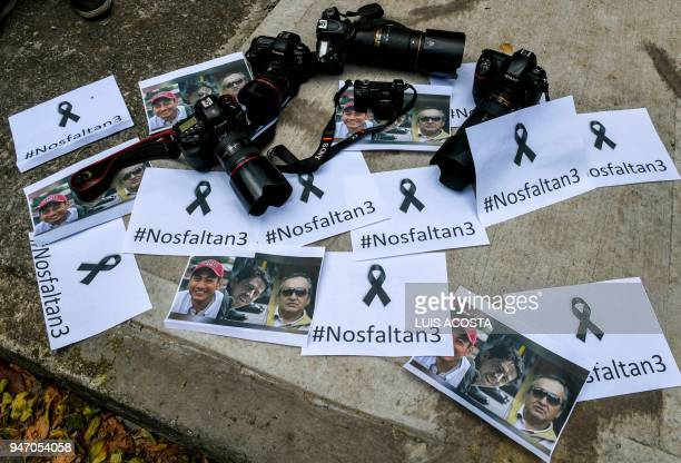 TOPSHOT Detail picture taken as Colombian journalists gather in front of the Ecuadorean embassy in Bogota to protest against the murder of Ecuadorean...