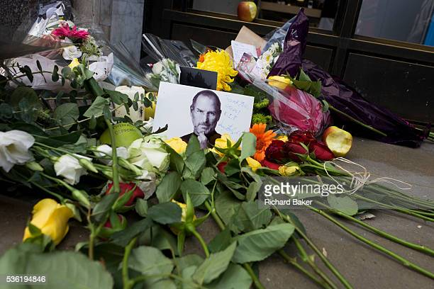 A detail portrait of Apple's creator Steve Jobs at a makeshift shrine where Londoners commemorate the morning after hearing of his death overnight...