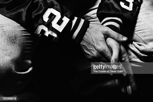 Detail portrait of the clasped hands of legendary Brooklyn/Los Angeles Dodgers lefthanded pitcher Sandy Koufax on July 12 1963 at the Polo Grounds...