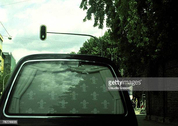 detail rear view of a hearse at green traffic light - hearse stock photos and pictures