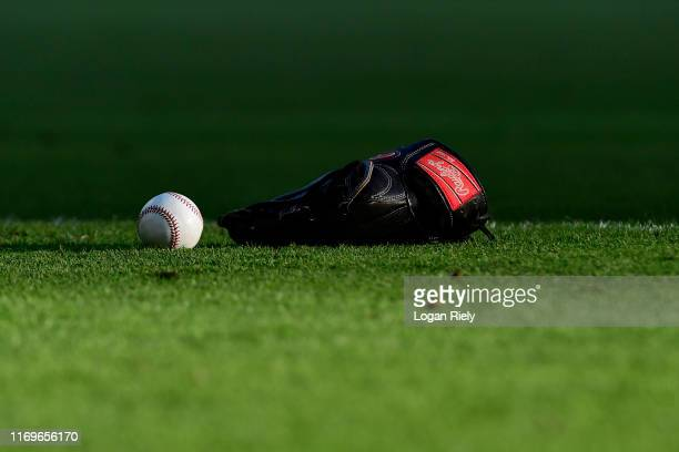 Detail shot of a bat and glove on the field before the Atlanta Braves vs Miami Marlins game at SunTrust Park on August 22 2019 in Atlanta Georgia