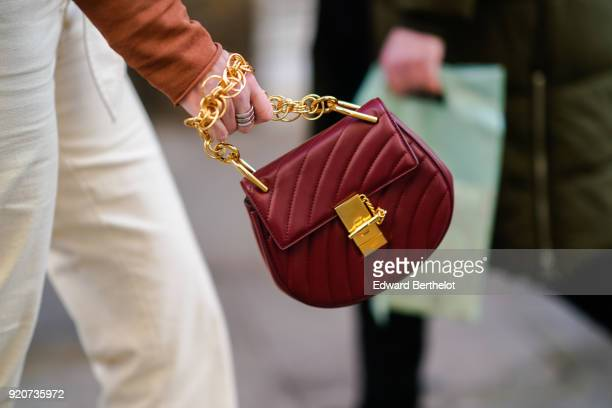 Detail shot of a Chloe bag made of red leather with a gold chain during London Fashion Week February 2018 on February 17 2018 in London England