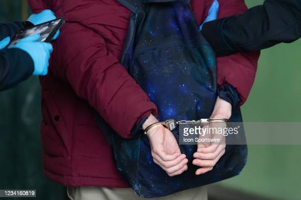 Detail shot of a demonstrator in handcuffs during the Freedom protest on July 24, 2021 in Melbourne, Australia. Freedom protests are being held in...