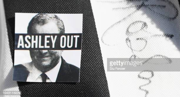 A detail shot of a Mike Ashley Out badge pictured on a fans shirt before the Premier League match between Newcastle United and Leicester City at St...
