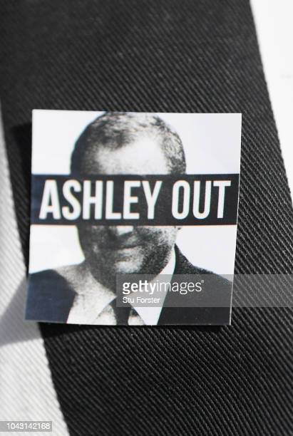 A detail shot of a 'Mike Ashley Out' badge pictured on a fans shirt before the Premier League match between Newcastle United and Leicester City at St...