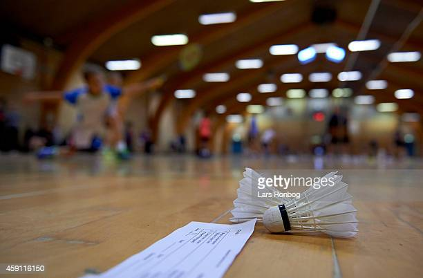 A detail shot of a shuttlecock and the scoreboard paper lying on the the court during the Yonex Denmark Junior Youth Badminton Tournament in Paarup...