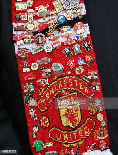 A detail shot of badges are seen on the scarf of a Manchester United supporter outside Old Trafford prior to the Barclays Premier League match...