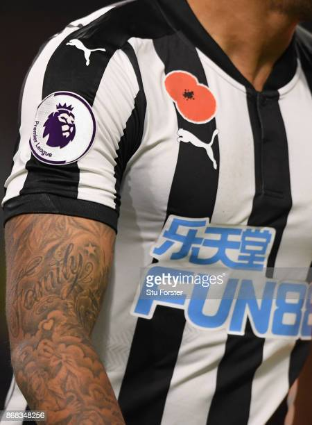 A detail shot of both the Premier League badge and the remembrance day poppy on the Newcastle playing shirt during the Premier League match between...
