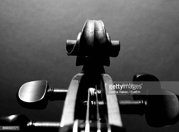 Detail Shot Of Cello Against Gray Background