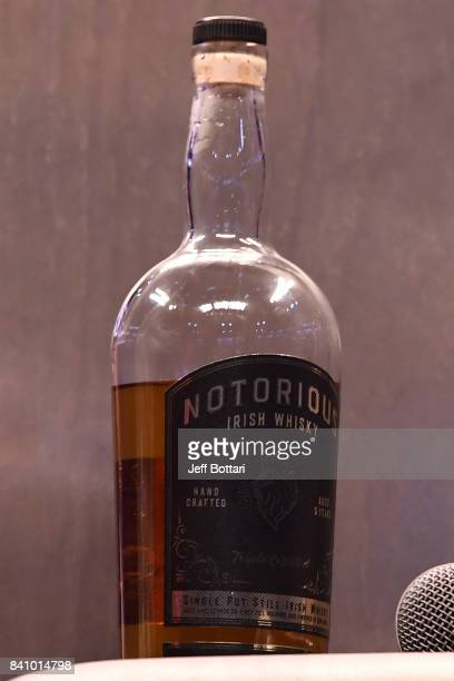 A detail shot of Conor McGregor's Notorious Irish Whiskey bottle during a news conference after Mayweather's 10thround TKO victory in their super...