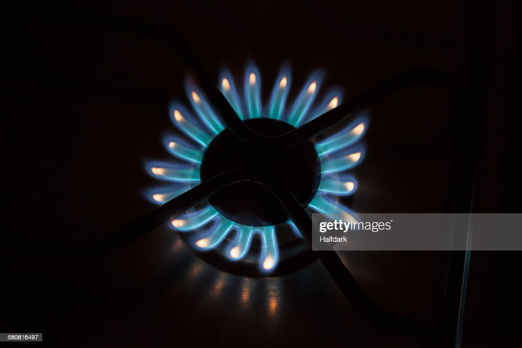 Detail shot of flames on gas burner : Stock Photo