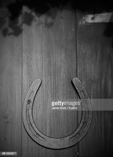 Detail Shot Of Horse Shoe On Wooden Surface