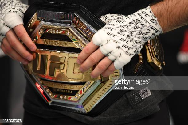 Detail shot of Khabib Nurmagomedov's belt after he announces his retirement in the Octagon after his victory over Justin Gaethje in their lightweight...