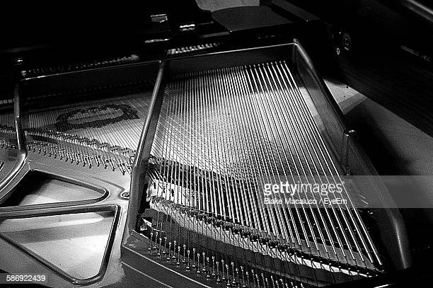 detail shot of piano - musical instrument string stock photos and pictures