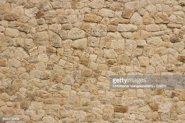 detail shot of stone wall - stone wall stock pictures, royalty-free photos & images