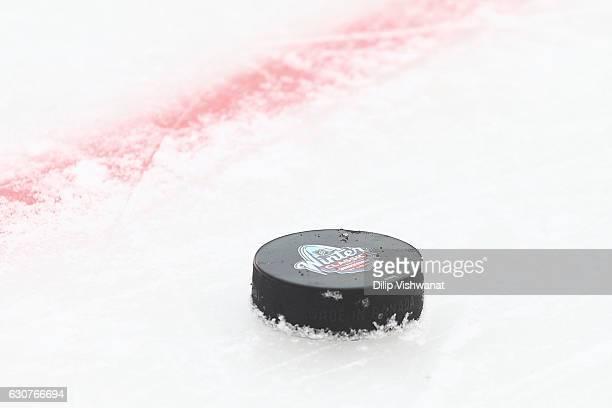 A detail shot of the 2017 Bridgestone NHL Winter Classic logo on a puck at the 2017 Bridgestone NHL Winter Classic Practice Day at Busch Stadium on...
