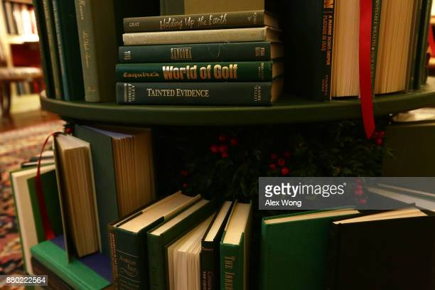 Detail shot of the book volumes that form a Christmas tree in the library at the White House during a press preview of the 2017 holiday decorations...