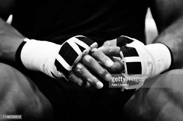 A detail shot of the hands of Anthony Joshua is seen as he tapes up prior to a training session during the Anthony Joshua Media Day at the English...
