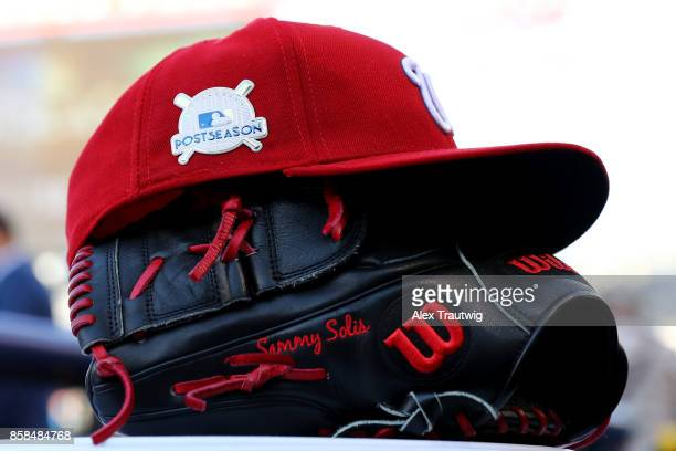 A detail shot of the hat and glove of Sammy Solis of the Washington Nationals prior to Game 1 of the National League Division Series against the...
