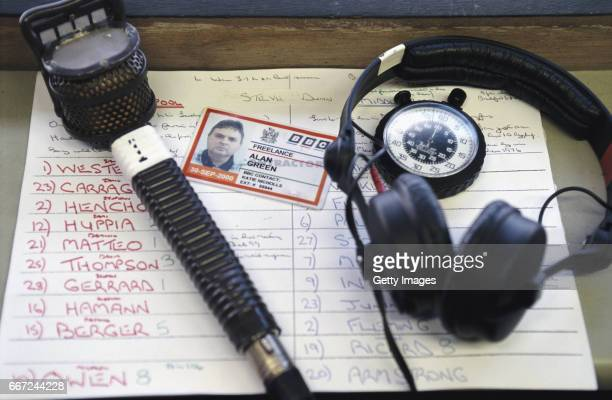 A detail shot of the his match notes and microphone of BBC Radio 5 Broadcaster Alan Green before a Premier League match between Liverpool and...