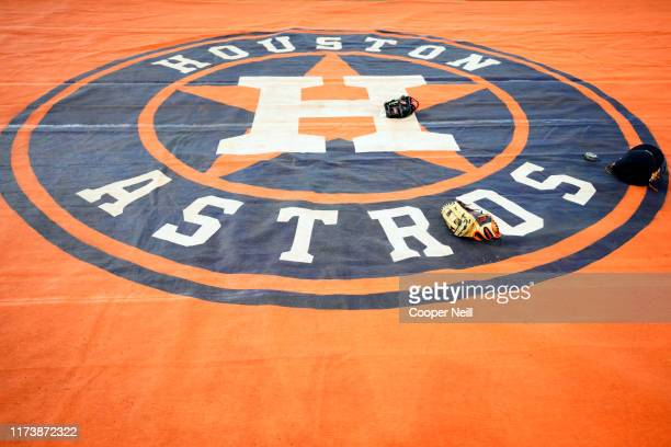 A detail shot of the Houston Astros logo on the tarp on the field during batting practice prior to Game 2 of the ALDS between the Tampa Bay Rays and...