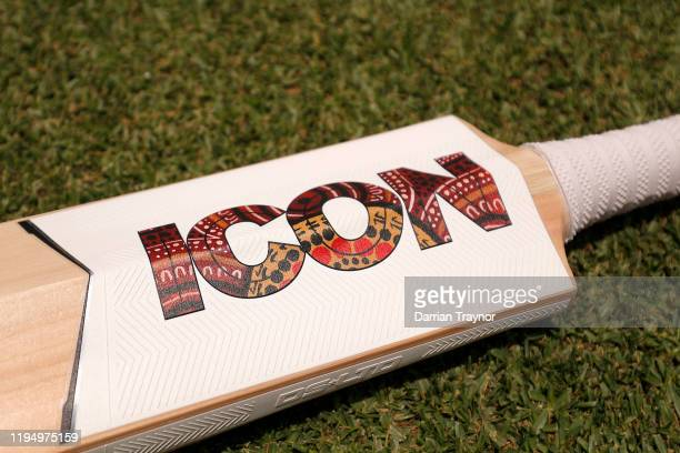 A detail shot of the Indigenous art work on the bat of D'arcy Short of the Hobart Hurricanes before the Big Bash League match between the Hobart...
