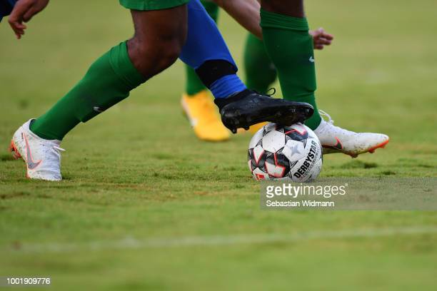 Detail shot of the legs of a player of Olching and Augsburg while competing for the ball during the preseason friendly match between SC Olching and...