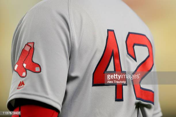 A detail shot of the number 42 on the back of Boston Red Sox first base coach Tom Goodwin during the game between the Boston Red Sox and the New York...