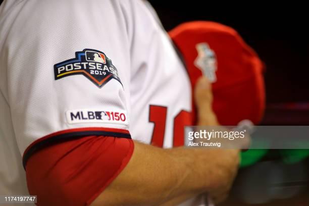 A detail shot of the Postseason logo on the sleeve of a Washington Nationals player during singing of the national anthem prior to Game 3 of the NLDS...